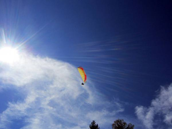 Try local paragliding in the village